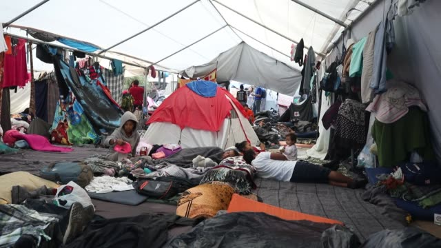 migrants from central america wait in a makeshift shelter at benito juarez sports unit on november 28 2018 in tijuana mexico near the border with the... - emigration and immigration stock videos & royalty-free footage