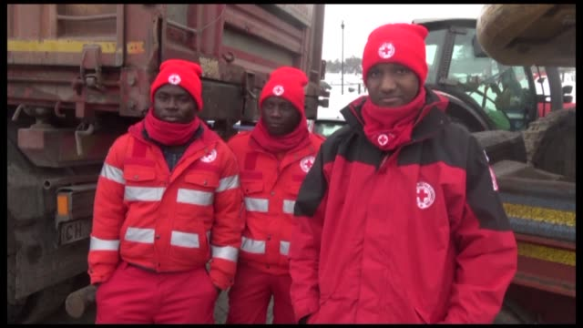 migrants from guinea and senegal prepare to head to the site of the hotel hit by an avalanche in central italy after offering their services to the... - red cross stock videos & royalty-free footage