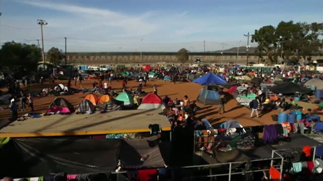 migrants from the central american migrant caravan at a large refugee camp in tijuana on the mexican side of the border with the usa - geographical border stock videos & royalty-free footage