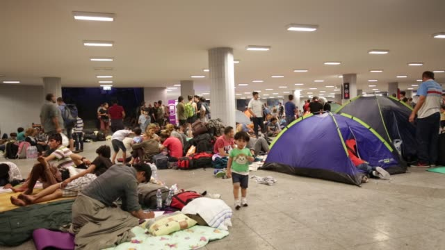 Migrants gather in the transit zone of Keleti station in central Budapest on September 2 2015 in Budapest Hungary The station was closed today and...