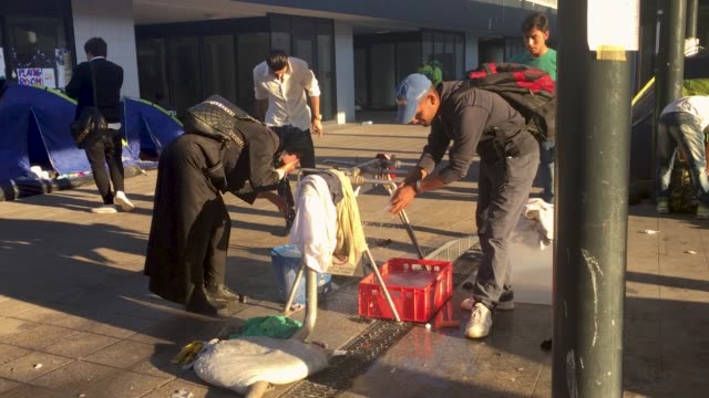 migrants in budapest are concerned that governments will soon close or severely limit continued travel access to austria and germany since the... - wasserpumpanlage stock-videos und b-roll-filmmaterial
