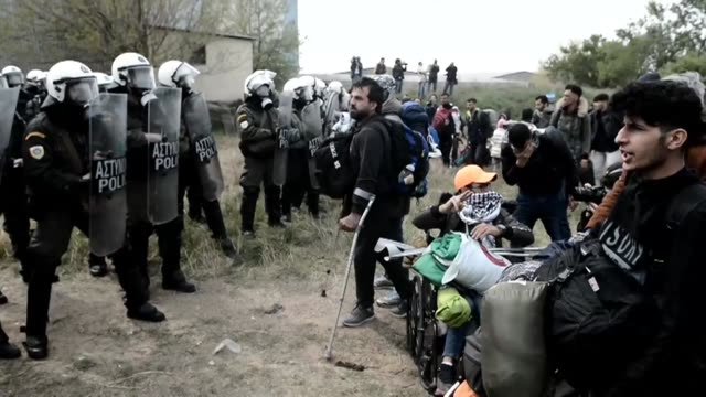 migrants protest outside a camp in northern greece to demand access to the border and passage to other eu states with minor clashes breaking out when... - greece stock videos & royalty-free footage