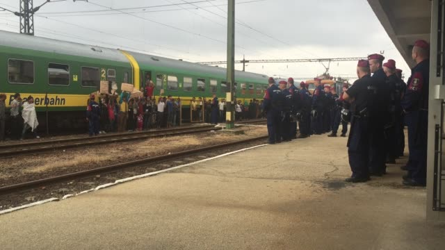 migrants protest outside a train that they are refusing to leave for fear of being taken to a refugee camp from the train that has been held at... - 2015 stock-videos und b-roll-filmmaterial