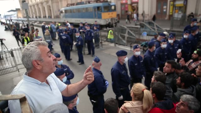 migrants wait for a to a train bound for the austrian border at the keleti railway station on september 9, 2015 in budapest, hungary. migrants in... - traditionally austrian stock videos & royalty-free footage