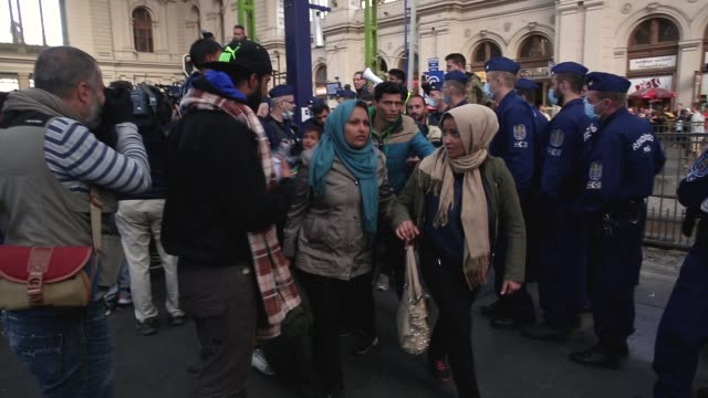 migrants wait for a to a train bound for the austrian border at the keleti railway station on september 9 2015 in budapest hungary migrants in... - traditionally austrian stock videos & royalty-free footage