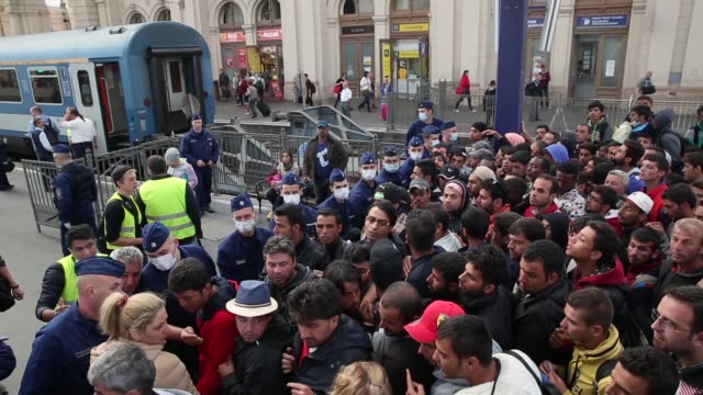 Migrants wait for a to a train bound for the Austrian border at the Keleti railway station on September 9 2015 in Budapest Hungary Migrants in...