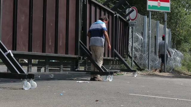 migrants wake up from their tents to a more peaceful morning near the motorway after the previous day's friction at the border crossings on september... - barricade stock videos & royalty-free footage