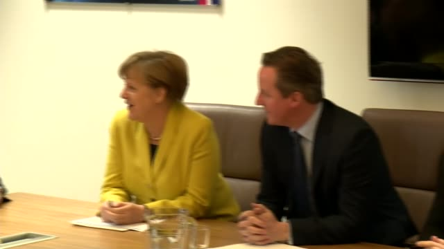 Cameron meets with Merkel and Hollande ****SOME BELGIUM Brussels INT TRACK into room where British Prime Minister David Cameron MP is sat at table...