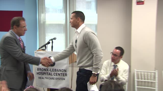 Miguel A Fuentes Jr introduces Alex Rodriguez at the BronxLebanon Hospital Center Dedication Ceremony to Alex Rodriguez at New York NY