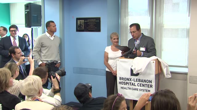 Miguel A Fuentes Jr reads the plaque to be awarded to Rodriguez at the BronxLebanon Hospital Center Dedication Ceremony to Alex Rodriguez at New York...