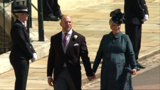 mike and zara tindall arrive for the wedding of prince harry and meghan markle at st george's chapel - königliche hochzeit stock-videos und b-roll-filmmaterial