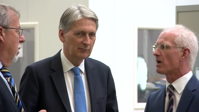 mike ashley buys house of fraser; england: coventry: mtc machining: int philip hammond mp chatting with other during factory tour philip hammons... - コベントリー点の映像素材/bロール