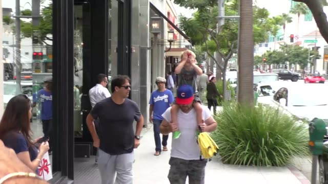 Mike Comrie walking with son on Brighton Way in Beverly Hills in Celebrity Sightings in Los Angeles