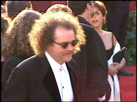 mike figgis at the 1996 academy awards arrivals at the shrine auditorium in los angeles, california on march 25, 1996. - 第68回アカデミー賞点の映像素材/bロール