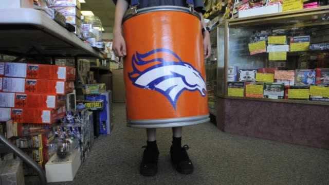 Mike Fruitman who owns Mikes Stadium Sports Cards in Aurora talks about purchasing a barrel worn by late Broncos superfan Tim McKernan during the...