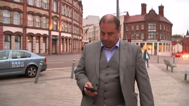 Mike Hookem denies punching colleague Steven Woolfe ENGLAND Bill Etheridge MEP walking along high street and interview SOT any talk of a big brawl or...