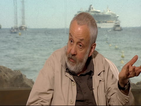 mike leigh on woody allen having taking the elixir of life and how his film is about getting old and life going by quickly and not having any pros or... - {{ contactusnotification.cta }} stock-videos und b-roll-filmmaterial