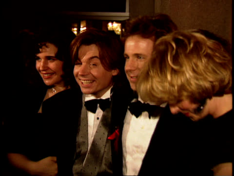 Mike Myers and Dana Carvey on the red carpet posing for press photographs at Swifty Lazar's Oscar Party