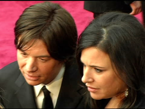 mike myers and robin ruzan at the 2005 annual academy awards arrivals at the kodak theatre in hollywood, california on february 28, 2005. - 77th annual academy awards stock videos & royalty-free footage