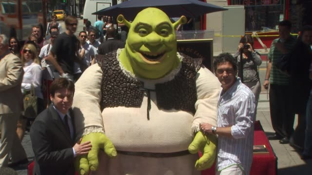 mike myers shrek and antonio banderas at the shrek honored with a star on the hollywood walk of fame at hollywood ca - mike myers actor stock videos & royalty-free footage