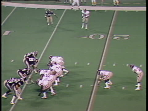 1984 ha ws mike rozier of pittsburgh maulers running with ball before michigan panthers players mike edwards, robert pennywell, larry bethea, and ray bentley tackle him / pontiac, michigan, usa - ポンティアック点の映像素材/bロール