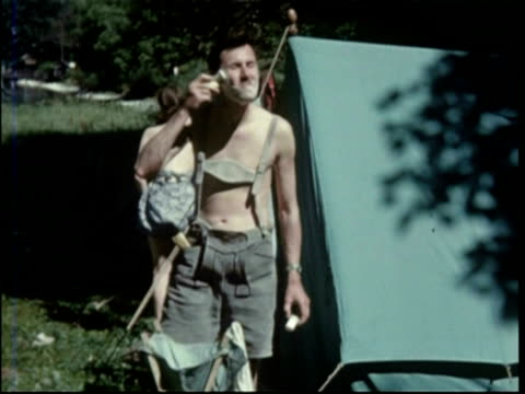mike stammers shaving in lederhosen shorts - shaving brush stock videos & royalty-free footage