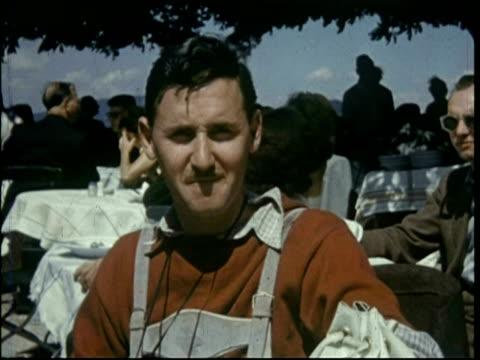 vídeos de stock e filmes b-roll de european holiday 1950; mike stammers wearing lederhosen in salzburg - 1955