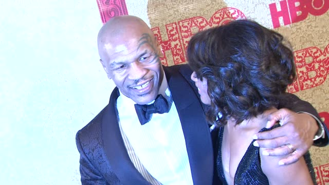 Mike Tyson and Angela Bassett at HBO's Post 2014 Golden Globe Awards Party at Circa 55 Restaurant on in Los Angeles California