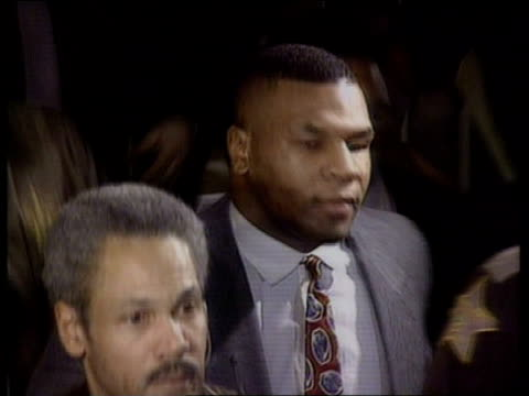 mike tyson guilty of rape usa indianapolis cms mike tyson down stairs at court tilt tyson out of court and into car pan lr - sexual violence stock videos and b-roll footage