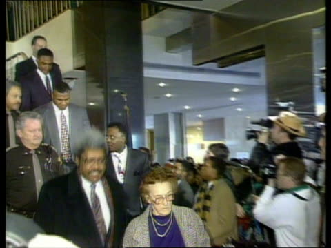 indiana indianapolis la ms don king camille ewald with mike tyson behind down stairs pan lr to bv out door - sexual violence stock videos & royalty-free footage