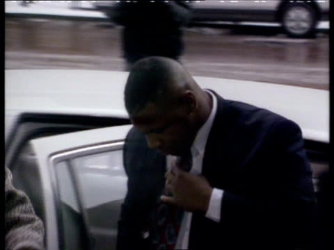 mike tyson gives evidence ext tcms tyson out of car pull out as rl and past - mike tyson boxer stock videos and b-roll footage