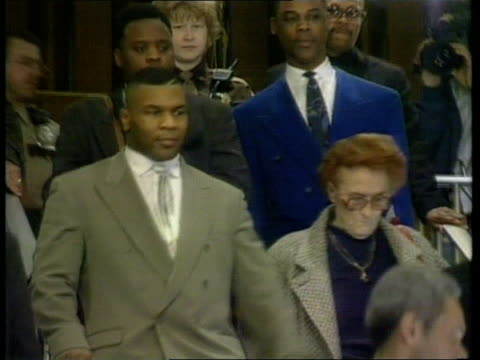mike tyson rape trial: mike tyson gives evidence; usa: indianapolis: int **beware flash photography** mike tyson and others towards leaving court and... - sexual violence stock videos & royalty-free footage