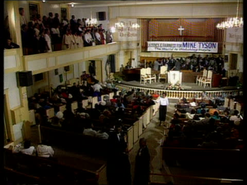 indianapolis tgv service in baptist church in session pan lr more ditto mike tyson shaking hands aas past people ltgv service as tyson on platform... - congregation stock videos and b-roll footage