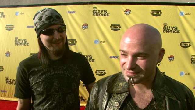 mike wengren and david draiman of disturbed on being nominated what makes them so 'ballsy' if they hope to win and where they'll put their trophy at... - spike guys choice awards video stock e b–roll