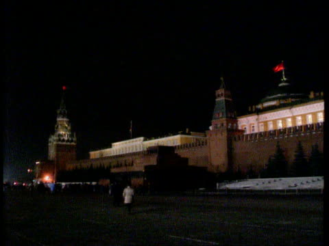 Mikhail Gorbachev resigns as President EXT / NIGHT Red flag flying on Kremlin GV Kremlin LA LS Red star atop building as eternal flame burning in f/g...