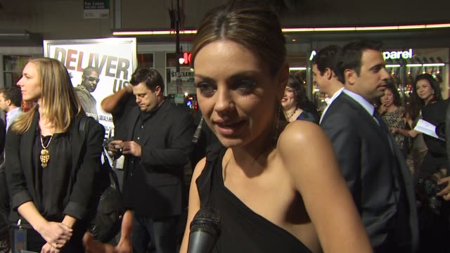 Mila Kunis on her role appeal of the film the action sequences the heavy subject matter at the 'The Book Of Eli' Premiere at Hollywood CA