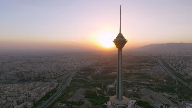 milad tower at sunset in tehran, iran. - teheran video stock e b–roll