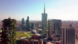 Milan, Italy - September 26, 2018: milan city skyline aerial view flying towards financial area skyscrapers