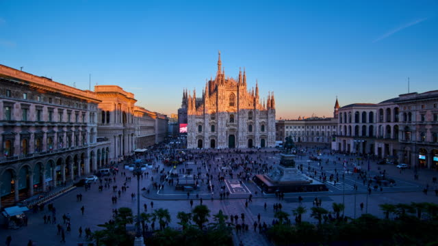 4k: milan piazza del duomo at day to night time lapse, italy - cathedral stock videos & royalty-free footage