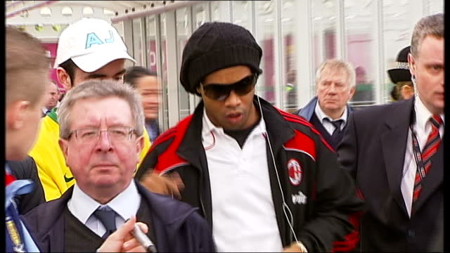 ac milan players arrive in glasgow scotland glasgow glasgow airport int ronaldinho mobbed by fans and signing autographs paulo maldini arrives at... - autographing stock videos & royalty-free footage