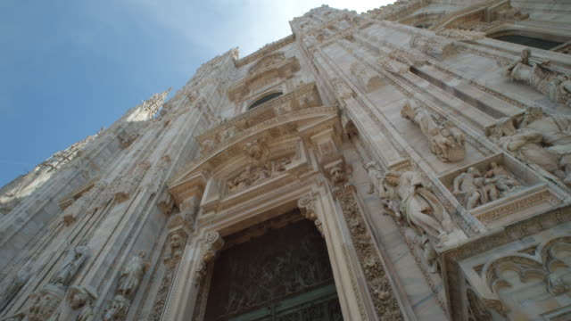 milano il duomo steady cam dolly shot looking up close up entering to the door - gothic style stock videos & royalty-free footage