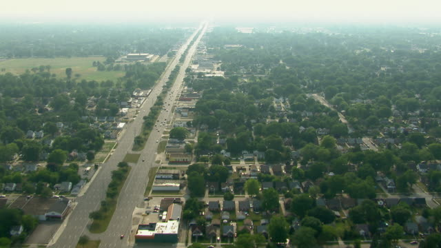8 mile road runs along the city limit between detroit and warren, michigan. - michigan stock videos & royalty-free footage