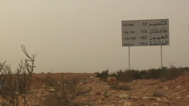 WS, Mileage sign in desert landscape, outside Guelmim, Agadir, Morocco