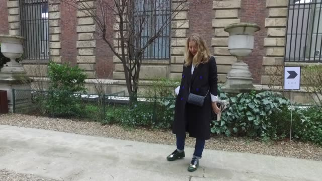 milena zhurblova wears marni shoes lavis jean celine shirt and brian oscar coat hermes scarf and chanel bag as she arrives at the nehara show street... - marni stock videos & royalty-free footage