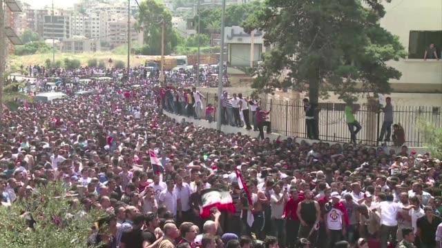 miles de sirios llenan este miercoles las calles para llegar hasta la embajada de su pais en beirut y votar en las elecciones presidenciales despues... - guerra civil stock videos and b-roll footage