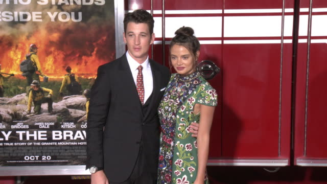 miles teller and keleigh sperry at the only the brave premiere at regency village theatre on october 08 2017 in westwood california - only the brave 2017 film stock videos & royalty-free footage