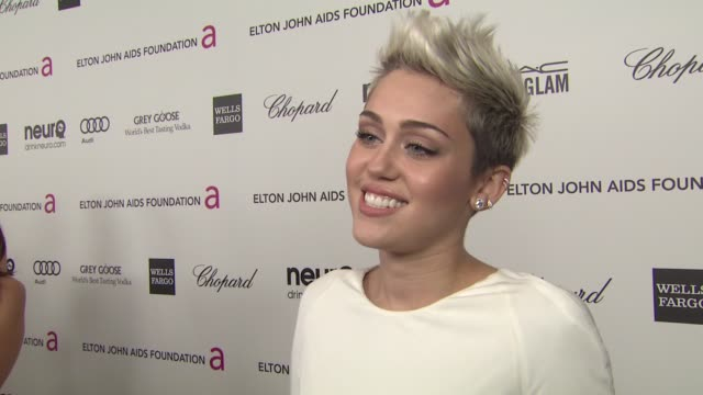 INTERVIEW Miley Cyrus at Elton John AIDS Foundation Presents 21st Annual Academy Awards Viewing Party 2/24/2013 in West Hollywood CA