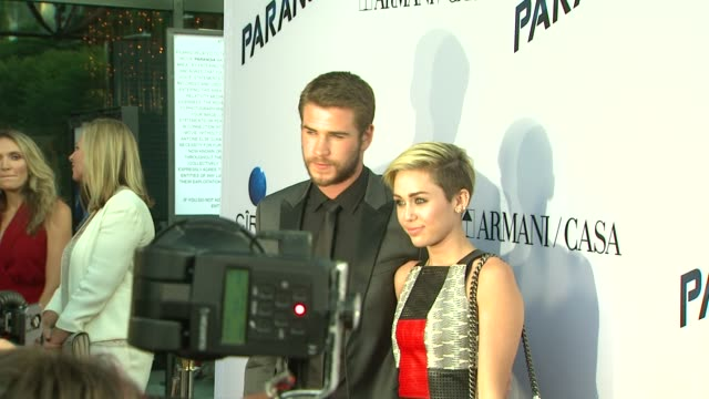 Miley Cyrus Liam Hemsworth at Paranoia Premiere on 8/8/13 in Los Angeles CA