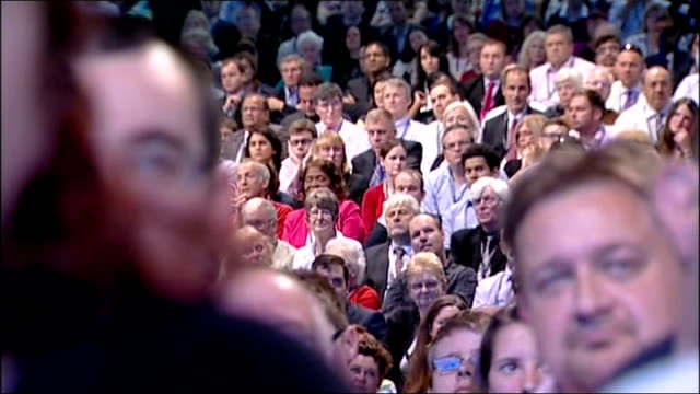 photography *** miliband onto stage delegates standing clapping miliband waving with party members on stage behind wide shot of conference ed... - kathy lette stock videos & royalty-free footage