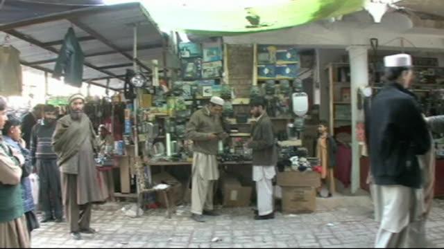 militants blow up bridge on key nato supply route into afghanistan; pakistan: peshawar: ext traffic in road at afghan-pakistan border sign reading... - bagnato bildbanksvideor och videomaterial från bakom kulisserna